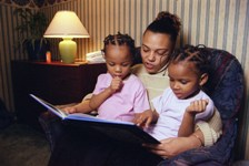 Picture of mother and children reading at home